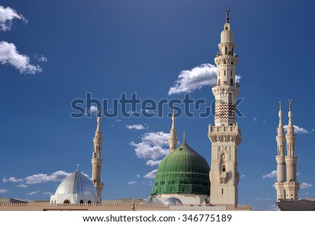 Exterior view of minarets and green dome of a mosque taken off the compound. - stock photo
