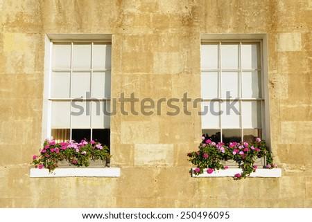 Exterior View of Old Sash Windows with Window Box Gardens of a Georgian Era English Town House - stock photo