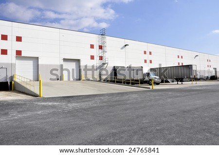 exterior view of unloading docks for a large warehouse