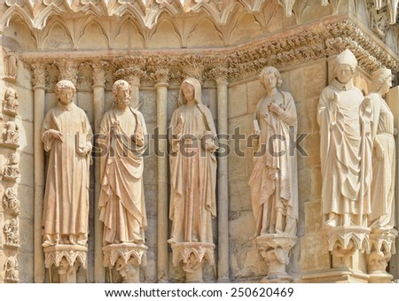 Exterior wall of Cathedral Our Lady of Reims or Notre-Dame de Reims with damages from Second World War - stock photo