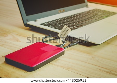 External hard disk connect to laptop - stock photo