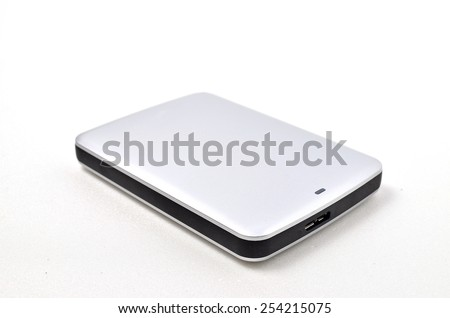 External Hard disk. Shoot over white background. Focus on the important part. Shallow depth of field. - stock photo