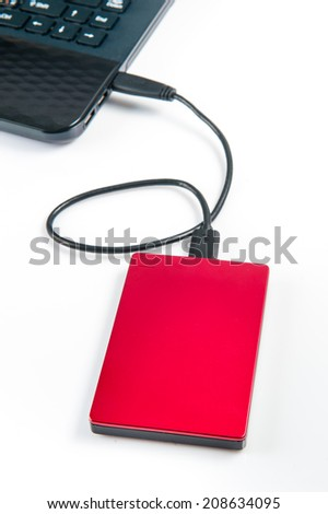 external hard drive connected to laptop - stock photo