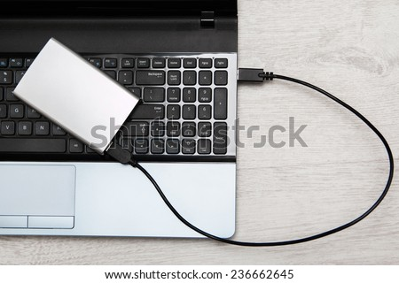 External HDD over laptop keyboard - stock photo