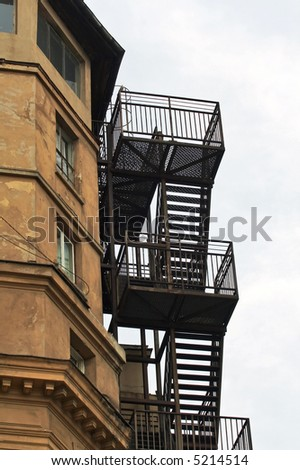 External metallic staircase of an old building - stock photo