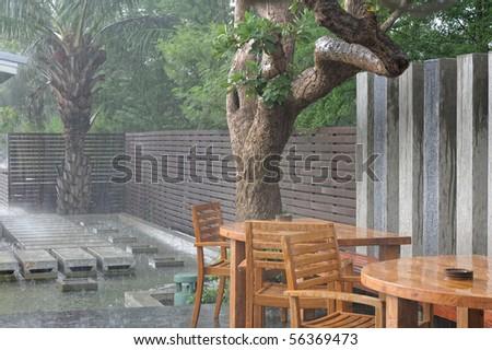 External Restaurant in Rain. - stock photo