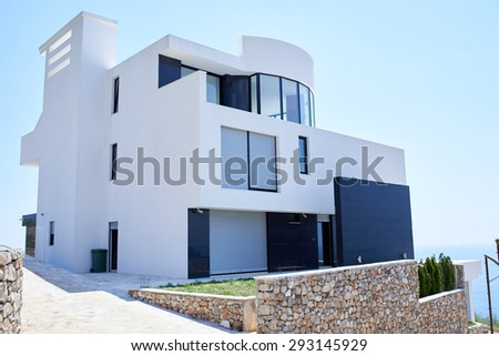 External view of a contemporary house modern villa at  sunset - stock photo