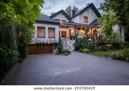 External view of luxury modern detached house - stock photo