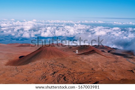 Extinct volcanic craters in background from Mauna Kea summit - stock photo