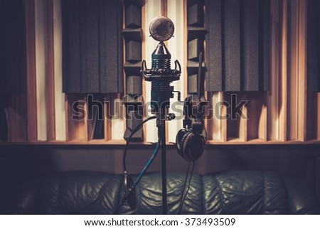 Extra high definition microphone at boutique recording studio. - stock photo