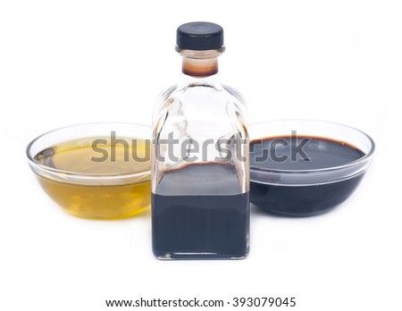 Extra virgin oil and balsamic vinegar in bowl separated on white background - stock photo