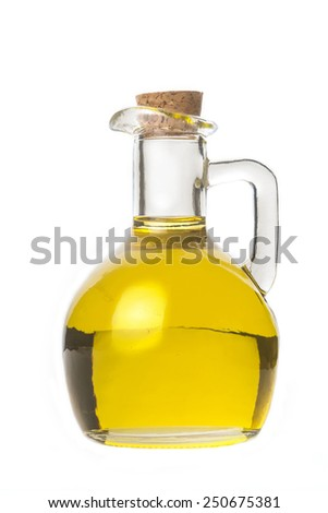Extra virgin olive oil, a glass with olive oil isolated on white background - stock photo