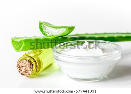 extract from aloe vera in glass bottle and cream macro