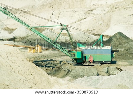 Extracting of amber ore in open-cast mining in Yantarny, Russia - stock photo