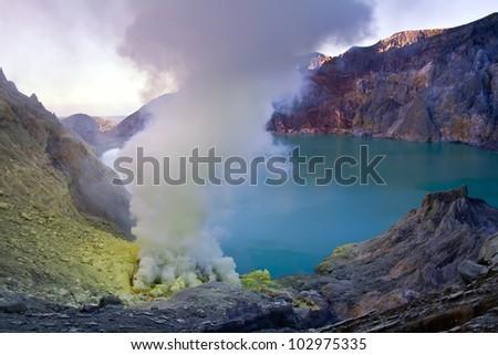 Extracting sulphur inside Kawah Ijen crater, Indonesia - stock photo