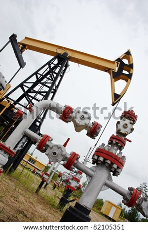 extraction of oil. pump jack and oil well. Western Siberia. Russia. - stock photo