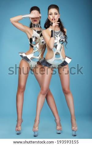 Extravagance. Two Heeled Women in Futuristic Clubwear. Hangouts - stock photo