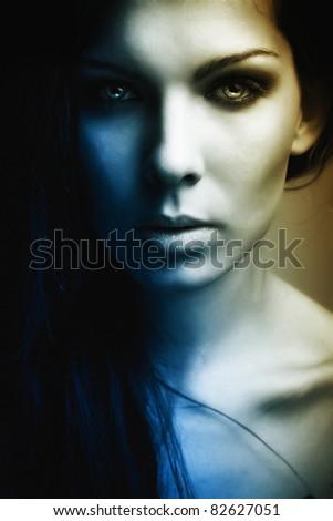 extravagant beautiful girl dark mystery portrait - stock photo