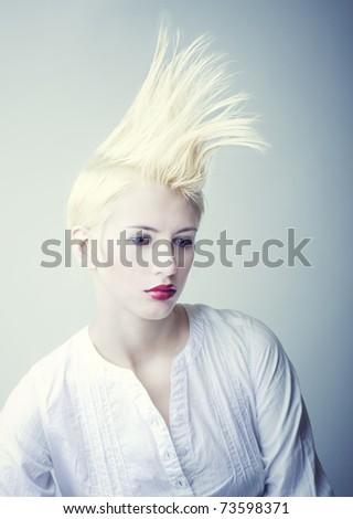 extravagant blond girl in white chemise - stock photo