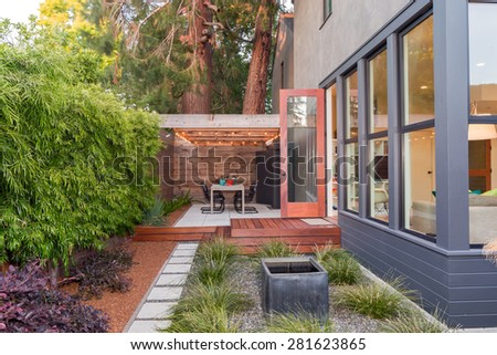 Extravagant Relaxing outside terrace with strong wooden beams and zen garden walk way. - stock photo