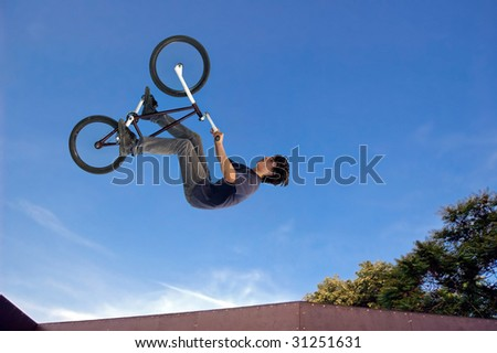 Extreme bicycle rider performing dangerous jumps with his bike.