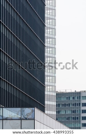 Extreme close up building windows. Isolated vertical view of modern commercial office building with vertical windows, architectural exterior. - stock photo