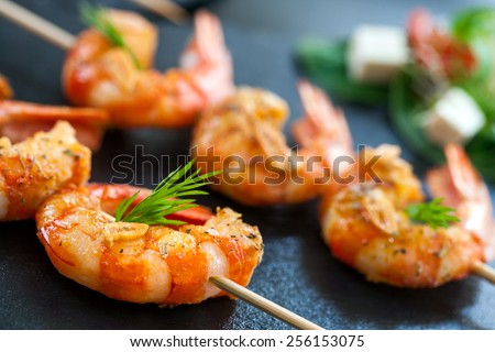 Extreme close up detail of appetizing queen prawn brochette. - stock photo