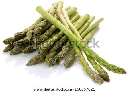 Extreme close-up image of fresh asparagus on white background - stock photo