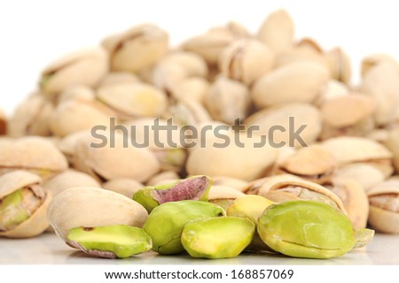 Extreme close-up image of pistachios with pistachios in background - stock photo