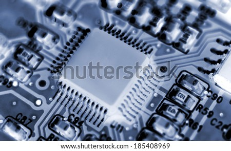 Extreme close up of a modern printed circuit board.(Shallow DOF) - stock photo