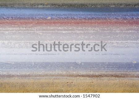 Extreme close-up of a single railroad track. - stock photo