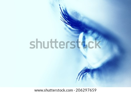 extreme close up of a woman eye - stock photo