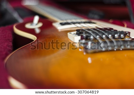 Extreme close-up of an electric guitar in its carry case. - stock photo
