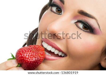 Extreme close up of attractive woman eating strawberry. - stock photo