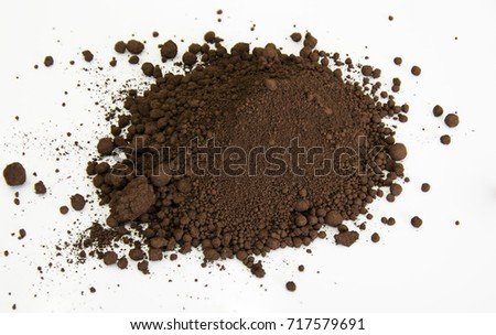 extreme close up of brown pigment isolated over white background