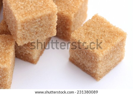 Extreme close-up of brown sugar cubes - stock photo