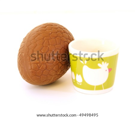 extreme close-up of chocolate egg, with white background