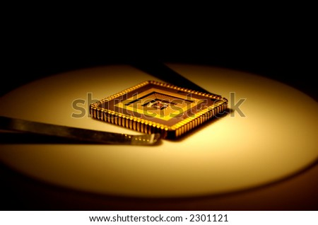 Extreme close-up of computer micro chip . - stock photo