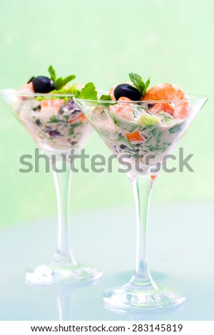 Extreme close up of Crab and shrimp cocktail served in stylish cocktail glasses. - stock photo