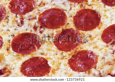 Extreme close-up of delicious pepperoni pizza - stock photo