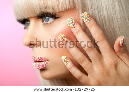 Extreme close up of fantasy make up with sugar sprinkle dots. - stock photo