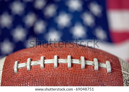 extreme close up of football with flag background - stock photo
