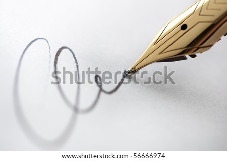 Extreme close up of fountain pen and signature. Selective focus with critical sharpness on tip of pen nib. - stock photo