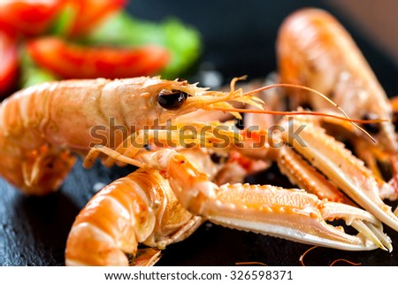 Extreme close up of large grilled spiny lobster dish. - stock photo