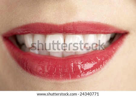 Extreme Close-Up Of Middle Aged Woman's Lips