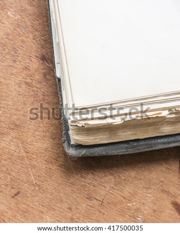 Extreme close up of old vintage book with blank page. Antique literature. White paper page with copy space. - stock photo