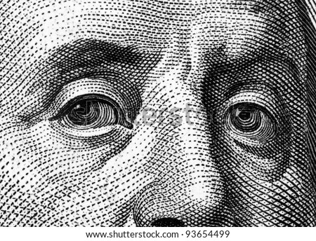 Extreme close-up of one hundred bill Franklin portrait.
