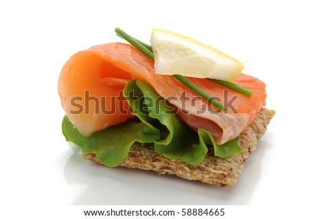 Extreme close-up of smoked salmon served with lemon and salad