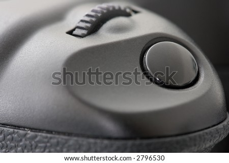 Extreme Close-Up of the Shutter Button in front of a professional Digital SLR-Camera. Shallow DOF. - stock photo