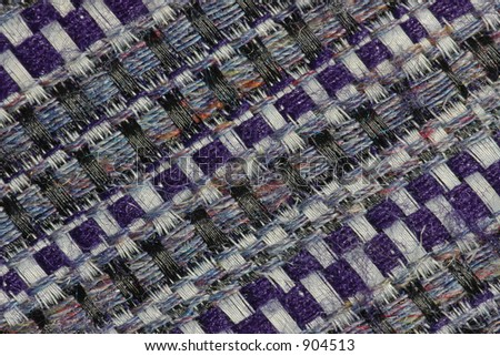 Extreme close-up of the weave of a man's tweed-style tie, revealing the secret of the fabric's subtle shades - stock photo